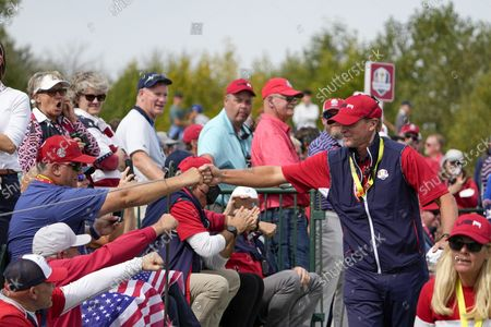 Team USA captain Steve Stricker greets fans on the second hole during a Ryder Cup singles match at the Whistling Straits Golf Course, in Sheboygan, Wis