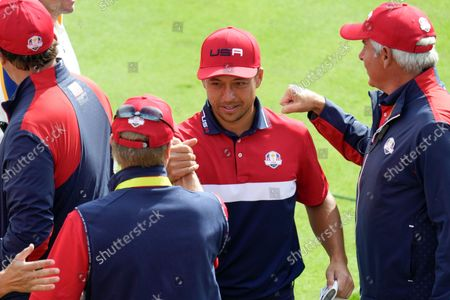 Team USA's Xander Schauffele is greated by Team USA captain Steve Stricker on the first tee during a singles match the Ryder Cup at the Whistling Straits Golf Course, in Sheboygan, Wis