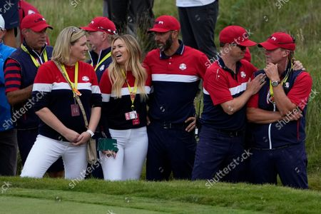 Team USA captain Steve Stricker is congratulated by assistant captain Zack Johnson after the Ryder Cup matches at the Whistling Straits Golf Course, in Sheboygan, Wis