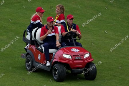 Team USA captain Steve Stricker gives Justin Thomas a ride after the Ryder Cup matches at the Whistling Straits Golf Course, in Sheboygan, Wis