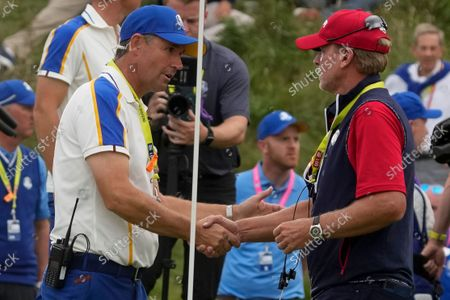 Team USA captain Steve Stricker shakes hands with Team Europe captain Padraig Harrington after the Ryder Cup matches at the Whistling Straits Golf Course, in Sheboygan, Wis
