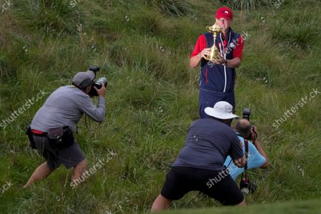 Stock Picture of Team USA captain Steve Stricker poses with the trophy after the Ryder Cup matches at the Whistling Straits Golf Course, in Sheboygan, Wis