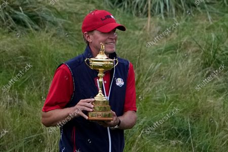 Stock Photo of Team USA captain Steve Stricker poses with the trophy after the Ryder Cup matches at the Whistling Straits Golf Course, in Sheboygan, Wis