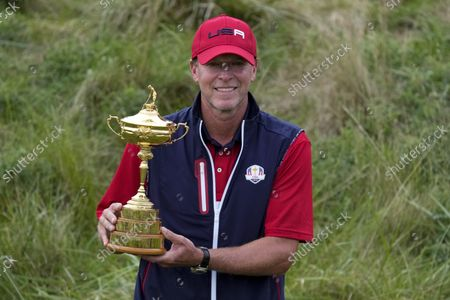 Team USA captain Steve Stricker poses with the trophy after the Ryder Cup matches at the Whistling Straits Golf Course, in Sheboygan, Wis