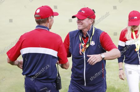 The US team's captain Steve Stricker (R) celebrates with vice-captain Davis Love III (L) after the US team captured the Ryder Cup with Collin Morikawa's match on the eigteenth hole during the Singles matches on the final day of the pandemic-delayed 2020 Ryder Cup golf tournament at the Whistling Straits golf course in Kohler, Wisconsin, USA, 26 September 2021.