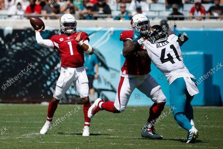 Arizona Cardinals quarterback Kyler Murray (1) throws a pass over Jacksonville Jaguars linebacker Josh Allen (41) during the first half of an NFL football game, in Jacksonville, Fla
