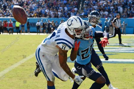 Indianapolis Colts wide receiver Michael Pittman Jr. (11) can't hold onto a pass as he is defended by Tennessee Titans cornerback Jackrabbit Jenkins (20) in the second half of an NFL football game, in Nashville, Tenn