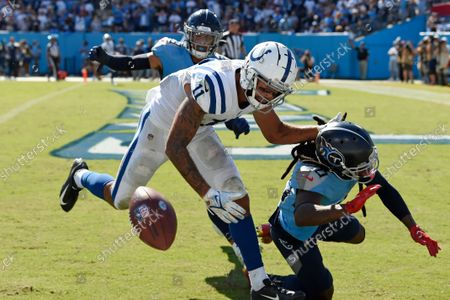 Stock Picture of Indianapolis Colts wide receiver Michael Pittman Jr. (11) can't hold onto a pass as he is defended by Tennessee Titans cornerback Jackrabbit Jenkins (20) in the second half of an NFL football game, in Nashville, Tenn