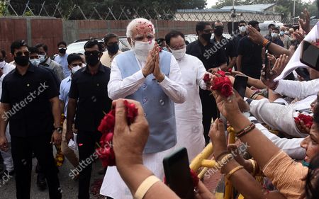 Prime Minister Narendra Modi received grand welcome by party leaders and workers on his returned at Palam Technical Area after concluding his three-day US visit, on September 26, 2021 in New Delhi, India. Narendra Modi arrived in India on Sunday afternoon after his three-day visit to the United States, which saw him deliver a key address at the United Nations General Assembly (UNGA) in New York and attend a series of crucial meetings with US president Joe Biden, vice president Kamala Harris and premiers of the Quad countries.