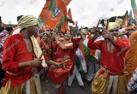 Supporters celebrate Prime Minister Narendra Modi's arrival from the US, at Palam technical Airport, on September 26, 2021 in New Delhi, India. Narendra Modi arrived in India on Sunday afternoon after his three-day visit to the United States, which saw him deliver a key address at the United Nations General Assembly (UNGA) in New York and attend a series of crucial meetings with US president Joe Biden, vice president Kamala Harris and premiers of the Quad countries.