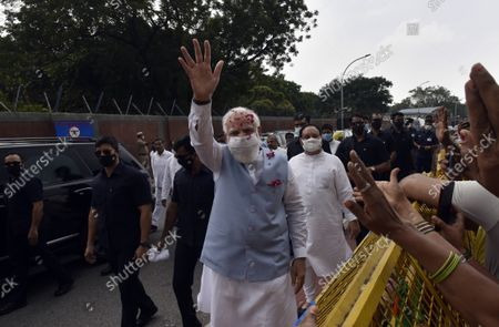 Prime Minister Narendra Modi waves at supporters upon his arrival from the US, at Palam technical Airport, on September 26, 2021 in New Delhi, India. Narendra Modi arrived in India on Sunday afternoon after his three-day visit to the United States, which saw him deliver a key address at the United Nations General Assembly (UNGA) in New York and attend a series of crucial meetings with US president Joe Biden, vice president Kamala Harris and premiers of the Quad countries.