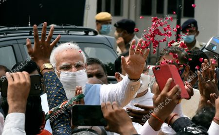 Stock Picture of Prime Minister Narendra Modi waves at supporters upon his arrival from the US, at Palam technical Airport, on September 26, 2021 in New Delhi, India. Narendra Modi arrived in India on Sunday afternoon after his three-day visit to the United States, which saw him deliver a key address at the United Nations General Assembly (UNGA) in New York and attend a series of crucial meetings with US president Joe Biden, vice president Kamala Harris and premiers of the Quad countries.