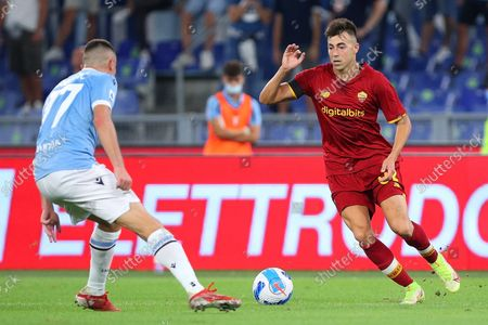 Stephan El Shaarawy of Roma (R) vies for the ball with Adam Marusic of Lazio (L)