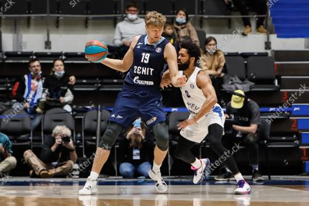 Mindaugas Kuzminskas (L) of Zenit and Silas Melson of Kalev in action during the VTB United League basketball match between BC Zenit St Petersburg and BC Kalev Cramo Tallinn on September 26, 2021 at Sibur Arena in Saint Petersburg, Russia.