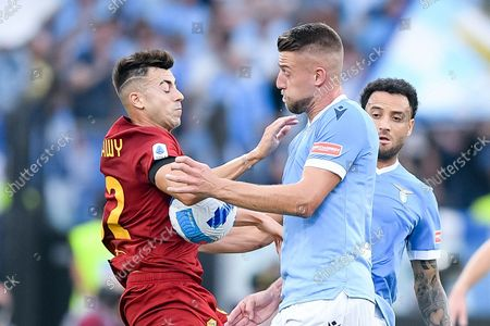 Sergej Milinkovic-Savic of SS Lazio and Stephan El Shaarawy of AS Roma compete for the ball during the Serie A match between SS Lazio and AS Roma at Stadio Olimpico, Rome, Italy on 26 September 2021.
