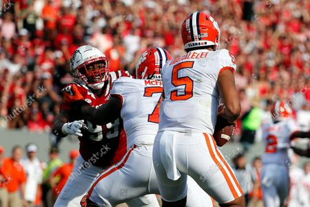 North Carolina State's Daniel Joseph (99) battles with Clemson's Jordan McFadden (71) as quarterback D.J. Uiagalelei (5) looks to pass during the first half of an NCAA college football game in Raleigh, N.C