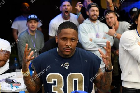 Stock Photo of Rapper YG poses for a photo during the first half of an NFL football game against the Tampa Bay Buccaneers, in Inglewood, Calif