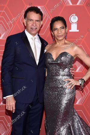 Brian Stokes Mitchell, left, and Allyson Tucker arrive at the 74th annual Tony Awards at Winter Garden Theatre, in New York