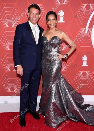 Stock Image of Brian Stokes Mitchell, left, and Allyson Tucker arrive at the 74th annual Tony Awards at Winter Garden Theatre, in New York