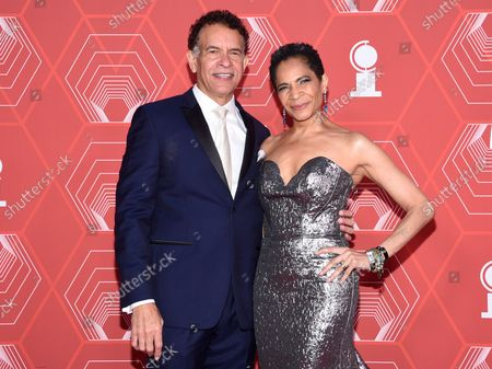 Stock Picture of Brian Stokes Mitchell, left, and Allyson Tucker arrive at the 74th annual Tony Awards at Winter Garden Theatre, in New York