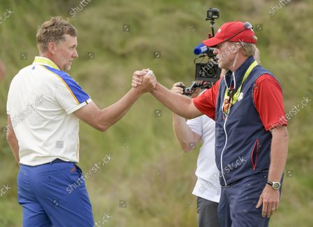 Team Europe's Ian Poulter shakes hands with Team USA Captain Steve Stricker after the USA's win of the the 43rd Ryder Cup at Whistling Straits on Sunday, September 26, 2021 in Kohler, Wisconsin.