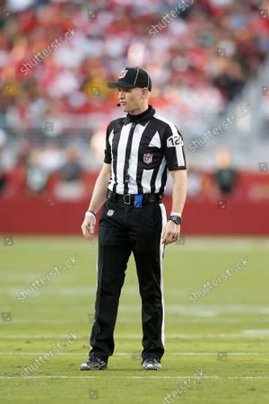 Stock Picture of Side judge Jonah Monroe (120) officiates the game between the San Francisco 49ers and the Green Bay Packers during an NFL football game, in Santa Clara, Calif