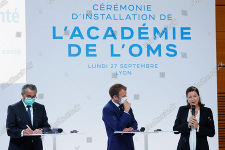 Agnes Buzyn (R), Executive Director of the World Health Organisation Academy, speaks during the WHO Academy opening ceremony chaired by French President Emmanuel Macron (C) and WHO Director-General Tedros Adhanom Ghebreyesus, in Lyon, France, 27 September 2021.