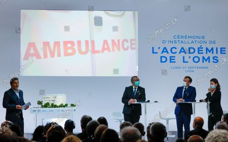 (2L-R) WHO Director-General Tedros Adhanom Ghebreyesus, French President Emmanuel Macron and Agnes Buzyn, Executive Director of the World Health Organisation Academy attend the WHO Academy opening ceremony, in Lyon, France, 27 September 2021.