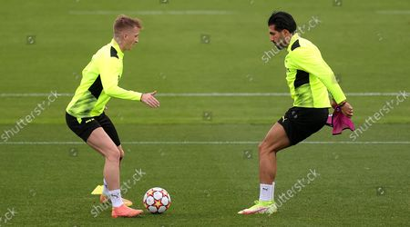Dortmund's Marco Reus (L) in action with Dortmund's Emre Can (R) during a training session in Dortmund, Germany, 27 September 2021. Borussia Dortmund will face Sporting CP on 28 September 2021 in their UEFA Champions League group stage soccer match.