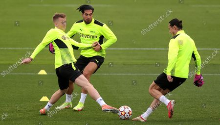 Dortmund's Marco Reus (L) in action with Dortmund's Emre Can (C) and Dortmund's Nico Schulz (R) during a training session in Dortmund, Germany, 27 September 2021. Borussia Dortmund will face Sporting CP on 28 September 2021 in their UEFA Champions League group stage soccer match.