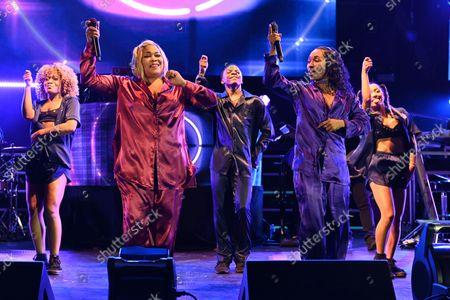 "Tionne ""T-Boz"" Watkins and Rozonda ""Chilli"" Thomas of TLC perform"