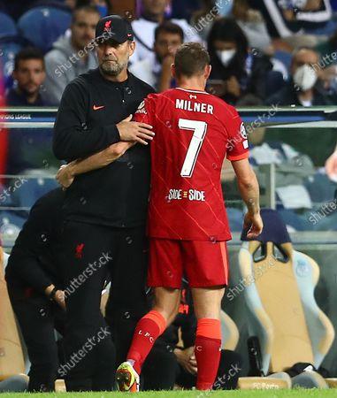 Liverpool manager Jurgen Klopp hugs James Milner of Liverpool