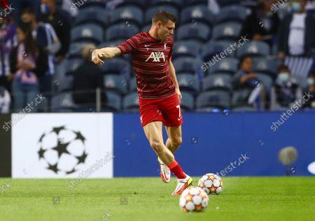 James Milner of Liverpool warms up