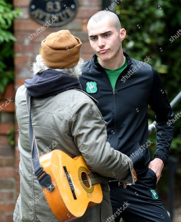 Exclusive - Corey shows his true colours when he threatens a busker who has evidence of him dumping a bag on the night that he murdered Seb.  Maximus Evans who plays Corey was seen with injuries to his face and wearing a Weatherfield County training kit in what promises to be an explosive storyline for Coronation Street.