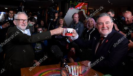 Stock Photo of Former Labour Leader Jeremy Corbyn and Barry Gardiner, MP at a fringe meeting for ÒStop Fire Re-HireÕ during the Labour party conference