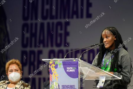 Ugandan climate activist Vanessa Nakate, right, speaks at the start of a three-day Youth for Climate summit in Milan, Italy, . Sitting at left is Patricia Espinosa, Executive Secretary of the United Nations Framework Convention on Climate Change (UNFCCC