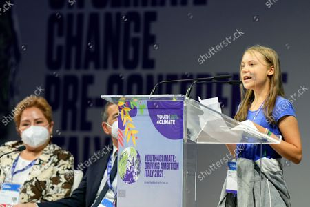 Swedish climate activist Greta Thunberg speaks during a three-day Youth for Climate summit in Milan, Italy, . Sitting at left is Patricia Espinosa, Executive Secretary of the United Nations Framework Convention on Climate Change (UNFCCC