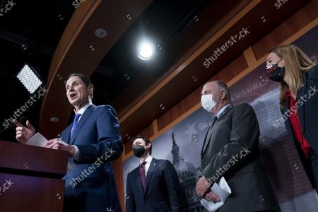Stock Picture of Sen. Ron Wyden, D-Ore., left, accompanied by from left, Sen. Jon Ossoff, D-Ga., Rep. Dan Kildee, D-Mich., and Rep. Mikie Sherrill, D-N.J., speaks during a news conference on the inclusion of Solar Tax Credit Legislation in the reconciliation bill on Capitol Hill in Washington