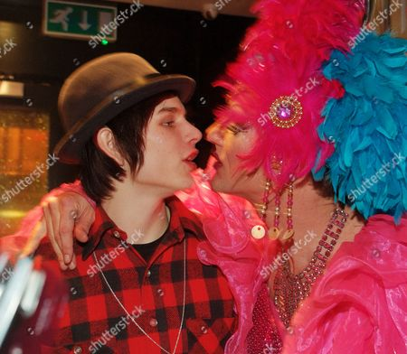 Luke Worrall puckering up for a kiss from a drag queen