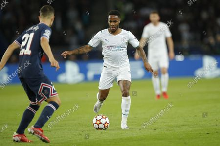 Paris Saint Germain's Ander Herrera (L) and Manchester City's Raheem Sterling in action during the UEFA Champions League group A soccer match between PSG and Manchester City at the Parc des Princes stadium in Paris, France, 28 September 2021.