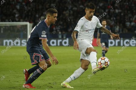 Paris Saint Germain's Ander Herrera (L) and Manchester City's Joao Cancelo in action during the UEFA Champions League group A soccer match between PSG and Manchester City at the Parc des Princes stadium in Paris, France, 28 September 2021.