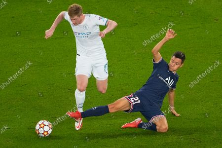Manchester City's Kevin De Bruyne, left, is tackled by PSG's Ander Herrera during the Champions League Group A soccer match between Paris Saint-Germain and Manchester City at the Parc des Princes in Paris