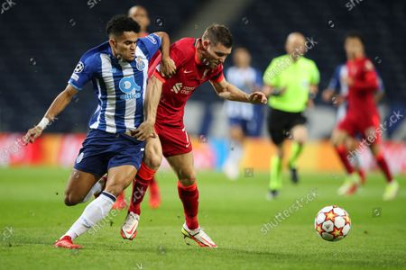 FC Porto player Luiz Diaz (L) in action against Liverpool's player James Milner during the UEFA Champions League group B soccer match held at Dragao stadium, Porto, Portugal, 28 September 2021.