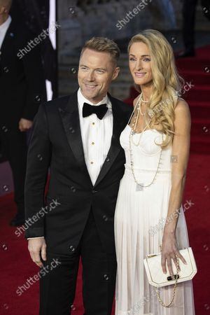Ronan Keating and Storm Keating pose for photographers upon arrival for the World premiere of the new film from the James Bond franchise 'No Time To Die', in London