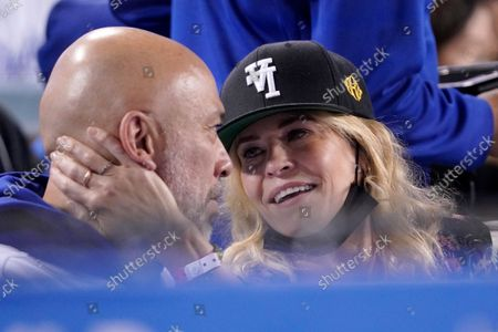 Stock Photo of Actress Chelsea Handler, right, caresses the face of comedian Jo Koy before kissing him during the fifth inning of a baseball game between the Los Angeles Dodgers and the San Diego Padres, in Los Angeles