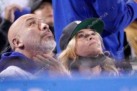 Actress Chelsea Handler, right, caresses the face of comedian Jo Koy during the fifth inning of a baseball game between the Los Angeles Dodgers and the San Diego Padres, in Los Angeles