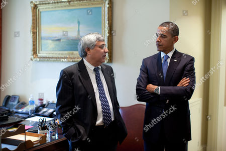 President Barack Obama talks with interim Chief of Staff Pete Rouse in the Outer Oval Office