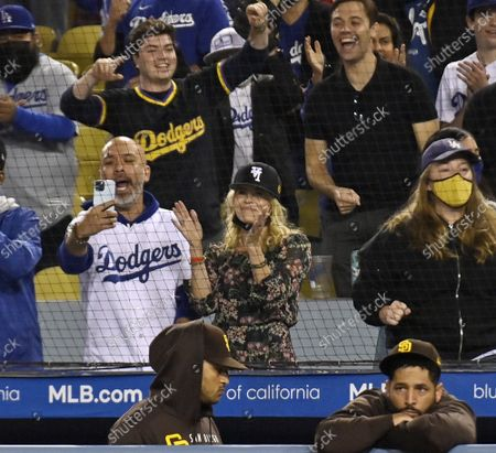 Actress Chelsea Handler and her boyfriend Jo Koy attend the Los Angeles Dodgers game against the San Diego Padres at Dodger Stadium in Los Angeles on Tuesday, September 28, 2021. The Dodgers defeated the Padres 2-1 behind seven shutout innings from Walker Buehler.