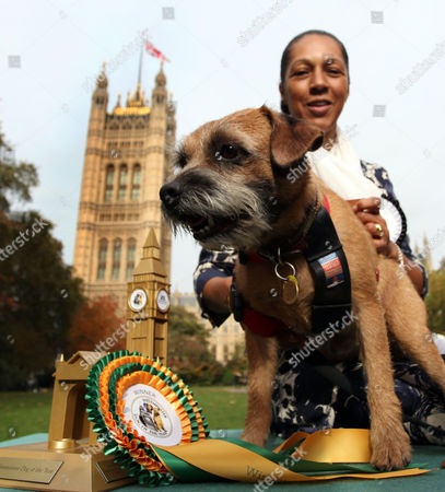 MP Helen Grant and her Border Terrier 'Charlie' with their winning rosette