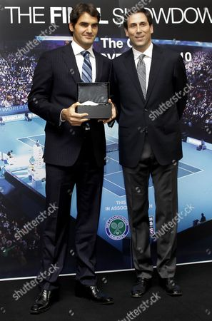 Roger Federer with ATP World Tour CEO Adam Helfant